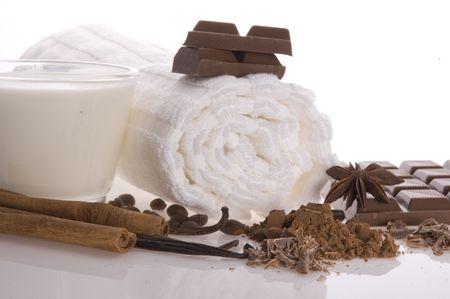 sensuality spa chocolate aromatherapy items - towel, milk, chocolate, anise stars, vanilla, cinnamon, cacao, coffee