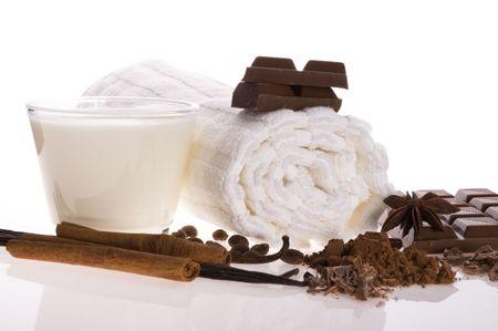 sensuality spa chocolate aromatherapy items - towel, milk, chocolate, anise stars, vanilla, cinnamon, cacao, coffee photo