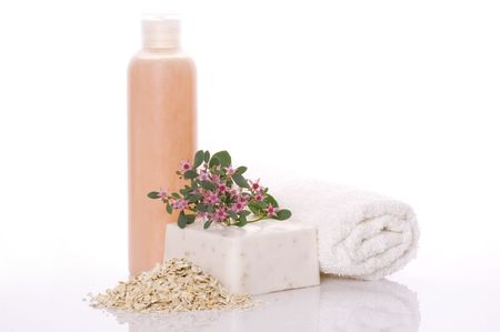 sopa: bath items. sopa, towel, liquid, flowers and oats
