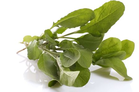 roquette: fresh rucola isolated on the white background Stock Photo