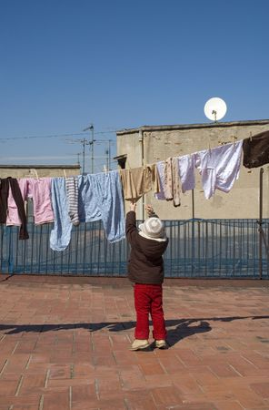 portrait of a sweet girl with the clothesline. urban scene photo