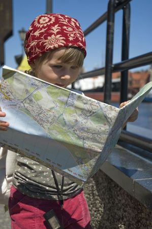 little girl with a city map. Gdansk. Poland photo
