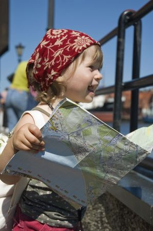 little girl with a city map. Gdansk. Poland Stock Photo - 4697510