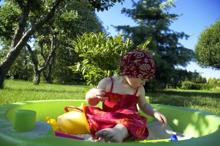 a cute little girl playing in the garden Stock Photo - 4697596