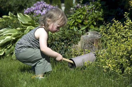 research kid. sweet girl in garden photo