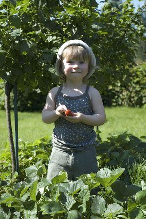two-year-old girl enjoying a fresh fruit photo