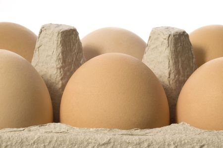 comestible: eggs in a grey cardboard carton box Stock Photo