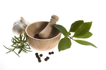 Mortar and pestle, with fresh-picked herbs photo