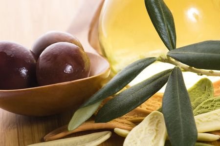 pasta, black olives, oil with fresh branch. food ingredients  photo