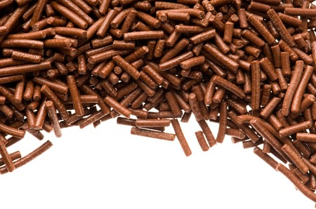 sweettooth: chocolate sprinkles on white background  Stock Photo