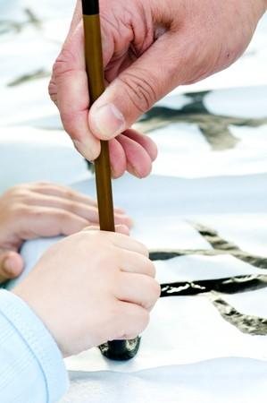 Teacher Helping Student drawing hieroglyph  photo