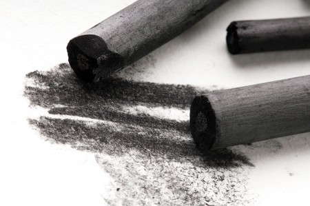 Artists black charcoal with smudge photo