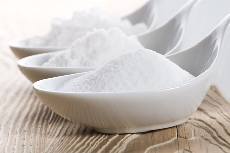 three spoons with difrent salt  photo
