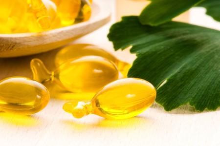 ginko biloba essential oil with fresh leaves - beauty treatment  photo