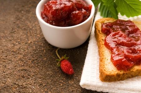 Wild strawberry jam with toast photo
