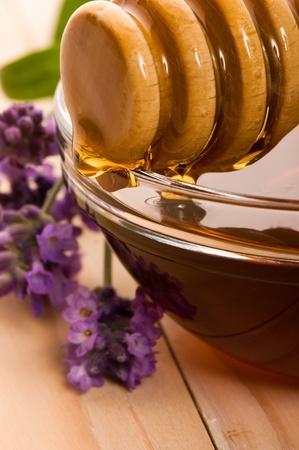 golden honey: lavender honey with fresh flowers. sweet food  Stock Photo