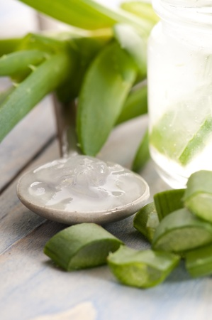 aloe vera juice with fresh leaves photo