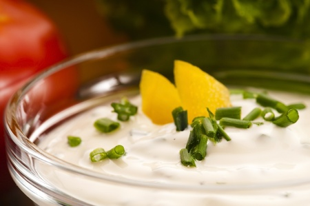 Delicious cream cheese with chives and vegetables photo