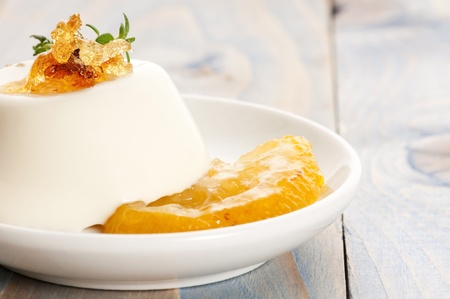 pannacotta: Vanilla Panna Cotta Dessert with lemon and fresh herbs Stock Photo