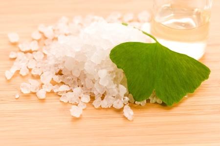 dragee: fresh leaves ginko biloba essential oil and sea salt - beauty treatment Stock Photo