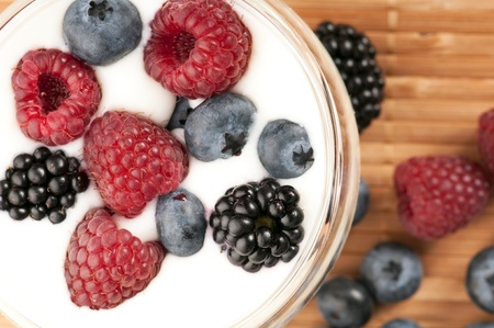 Yogurt with blueberries, raspberries and blackberries photo