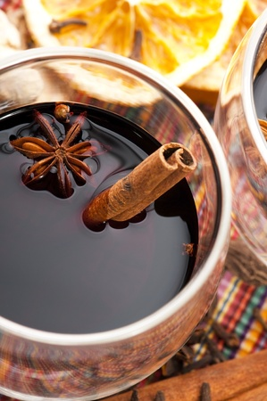 Mulled wine with slice of orange and spices. photo
