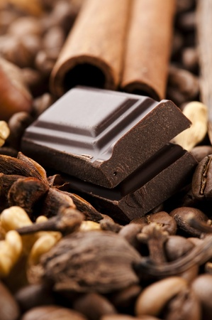 chocolate with coffee beans, spices and nuts photo