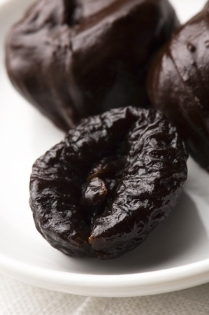 dried plums: Dried plums in chocolate  Stock Photo
