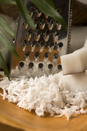 Grated coconut with grater and nut  photo