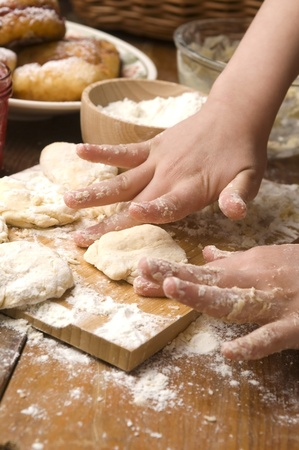 Detail of hands kneading dough Stock Photo - 13478597