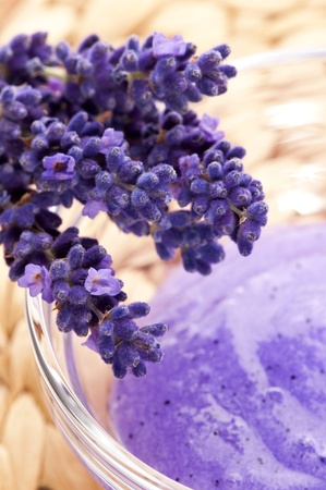 purifying: Lavender flowers and jar of glass with peeling Stock Photo
