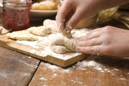 Detail of hands kneading dough Stock Photo - 13598590