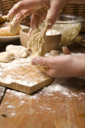 Detail of hands kneading dough Stock Photo - 13911072