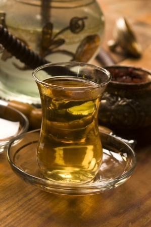 Cup of turkish tea and hookah served in traditional style photo