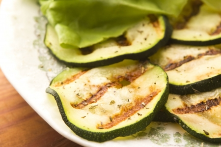Grilled organic zucchini slices with herbs and spices photo