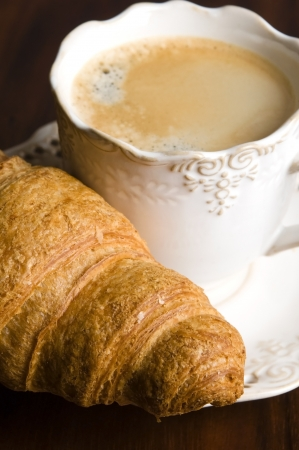 breakfast with cup of black coffee and croissants photo