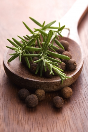 allspice with fresh rosemary photo