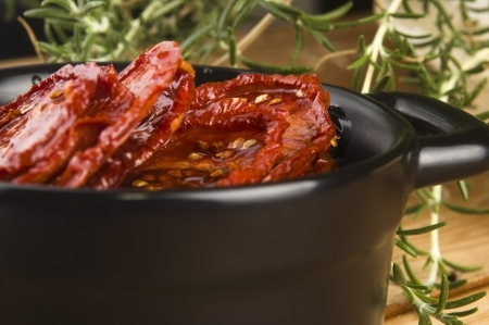 Sun dried tomatoes with olive oil photo