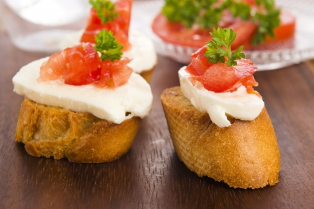 Bruschetta with mozarella and tomatoes photo