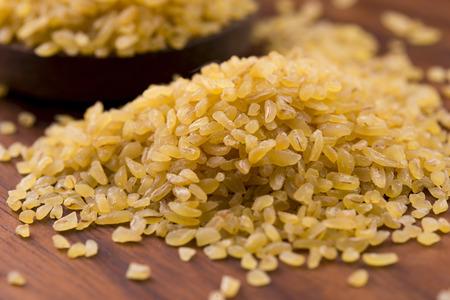 bulgur wheat in wooden spoon photo