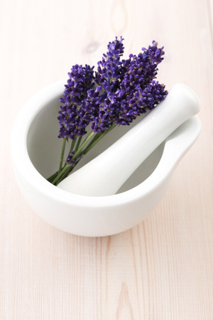trituration: Lavender flowers in a mortar Stock Photo