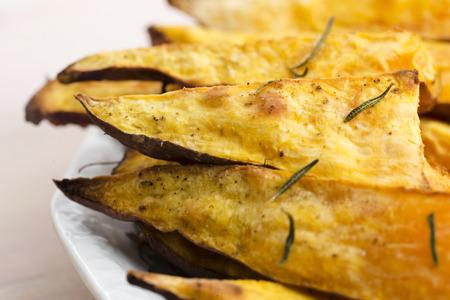 potato wedges: Portion of fresh baked sweet potato wedges