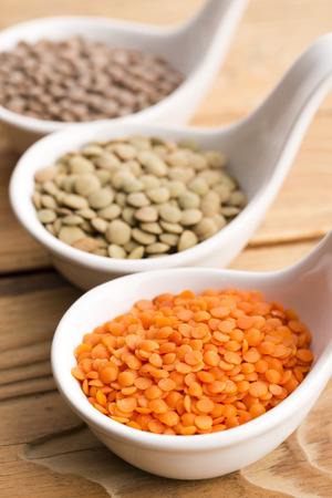 green lentil: Three kinds of lentil in bowls - red lentil, green lentil and brown lentil