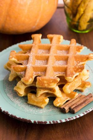 food backgrounds: pumpkin waffles with cinnamon sugar Stock Photo