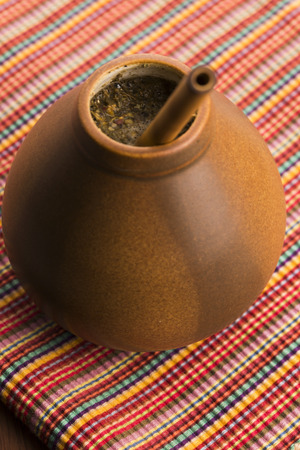 mate infusion: Calabash and bombilla with yerba mate