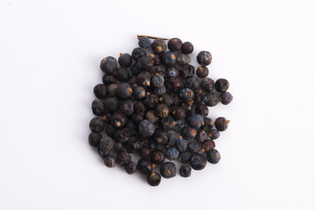 loose skin: Juniper berries on white background