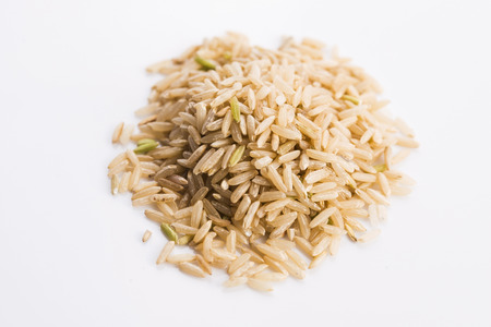 wholemeal: Whole rice pile on white background Stock Photo