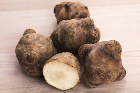 jerusalem artichoke: jerusalem artichoke on a wooden table Stock Photo