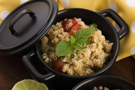 tabbouleh: Quinoa Tabbouleh with tomatoes onion parsley and lemon mint