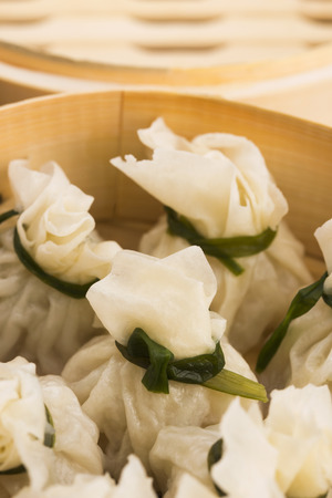 chinese dinner: Chinese dumplings in bamboo steamers